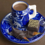 Chocolate Elixir in Cup with a truffle on a saucer